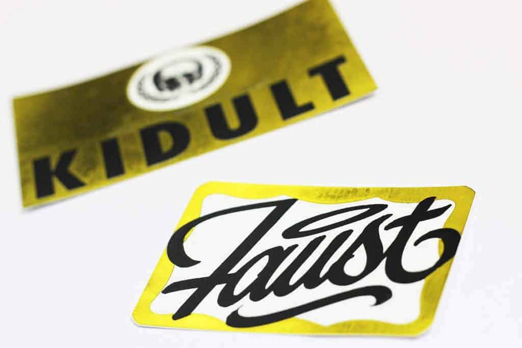""" Faust and Kidult was one of our first batches of custom stickers with gold foil effect. And, of course, much respect to both guys."""